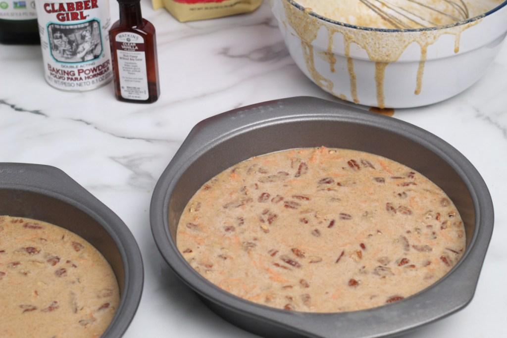 """keto carrot cake batter in 9"""" pans"""