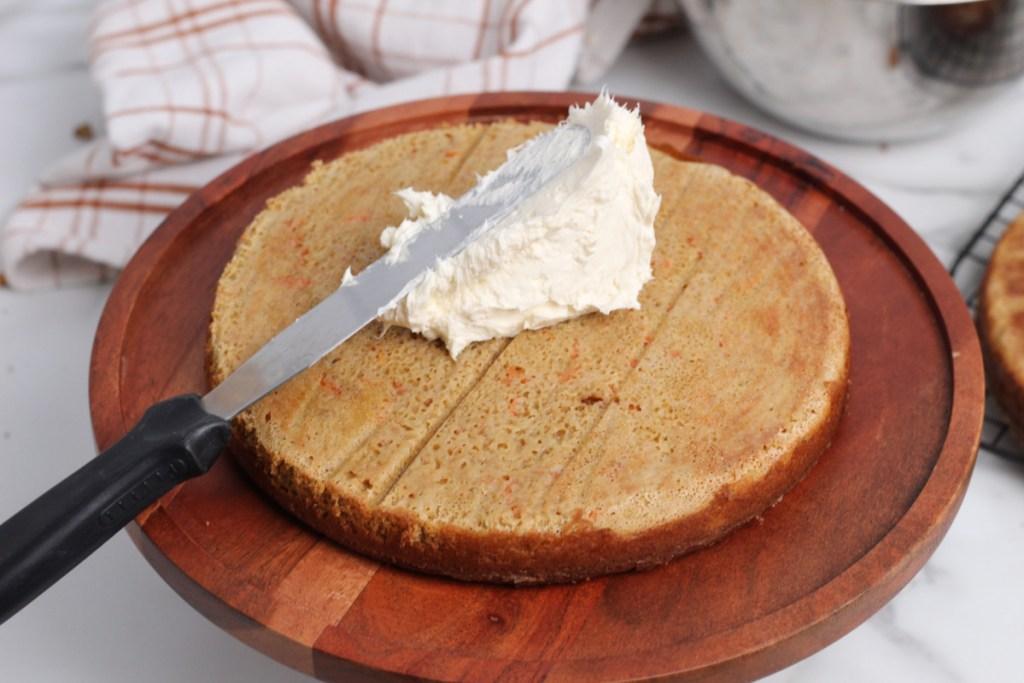 adding keto cream cheese frosting to cake