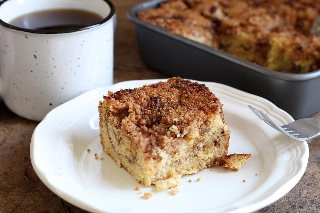 keto coffee cake on plate with coffee