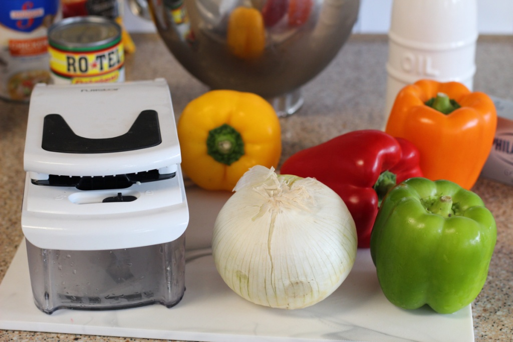 peppers and food chopper on cutting board