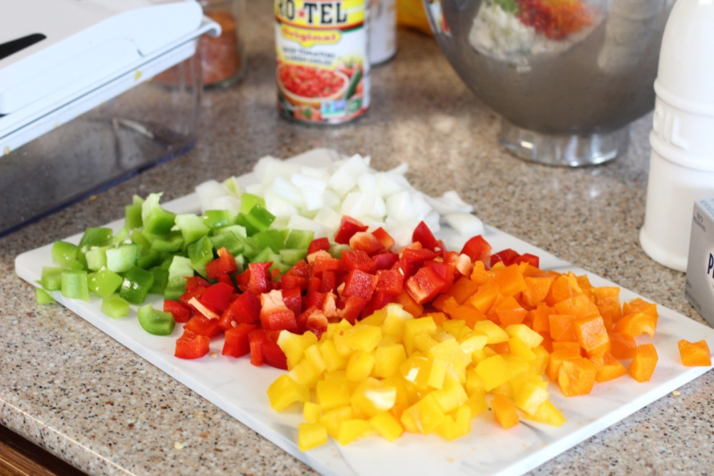peppers and onions chopped on cutting board