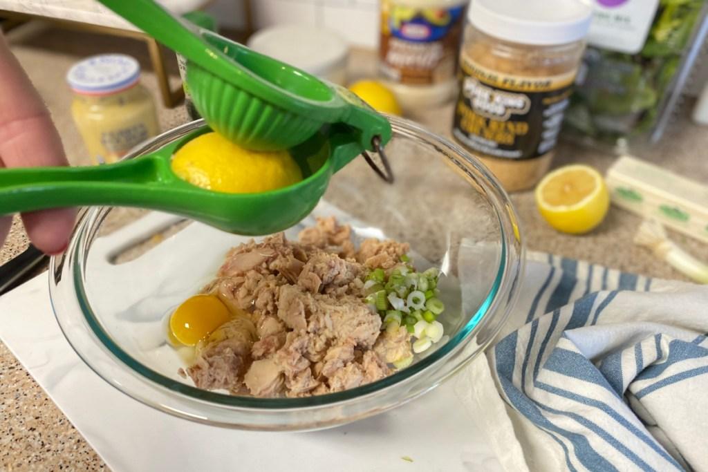 adding lemon juice to mixing bowl