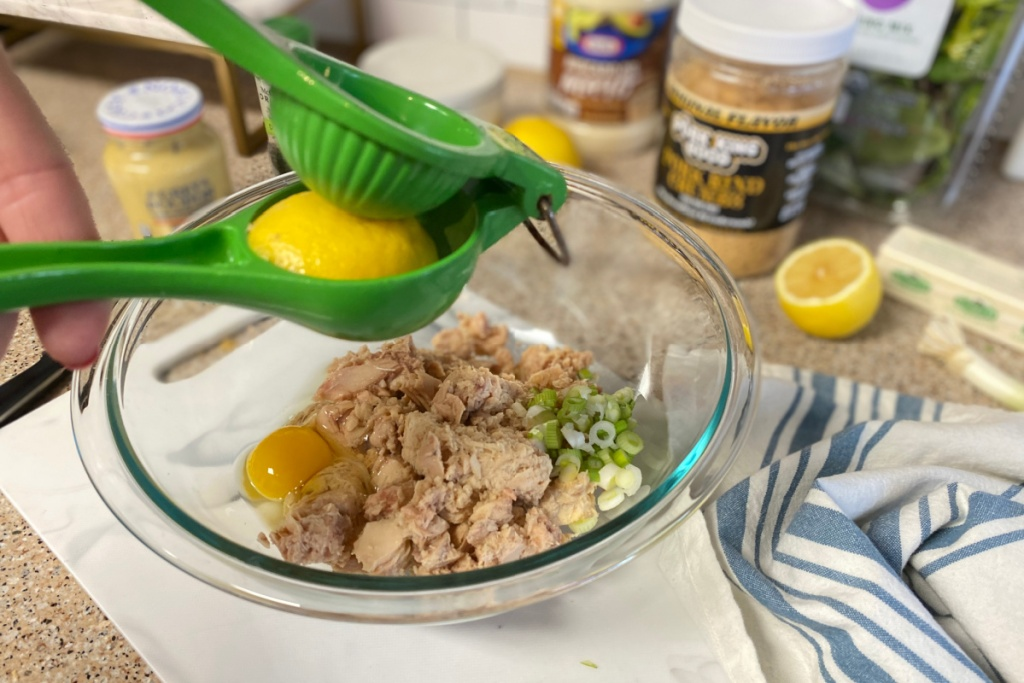adding lemon juice to mixing bowl