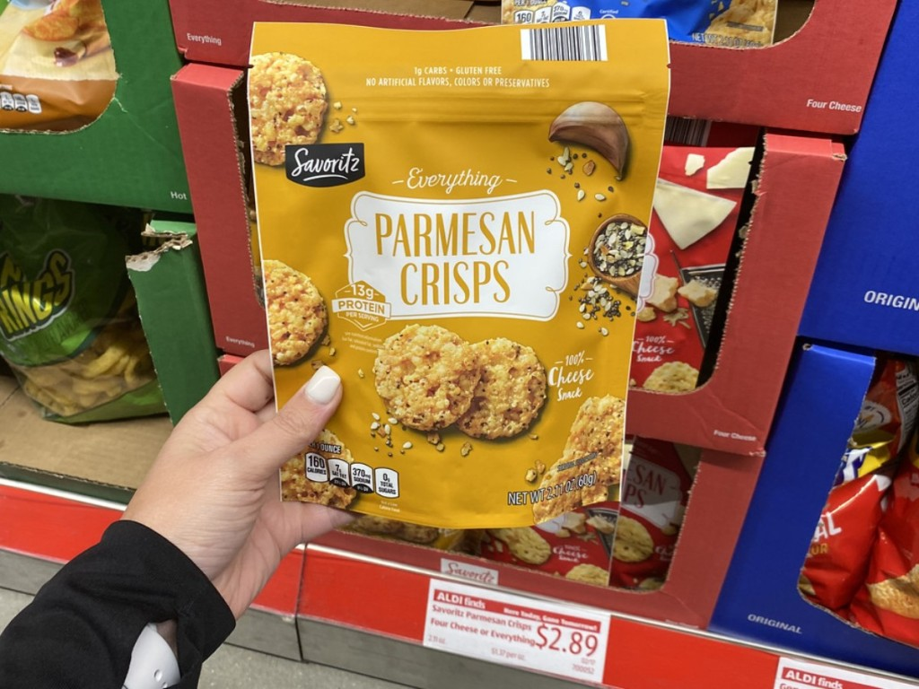 holding bag of parmesean crisps
