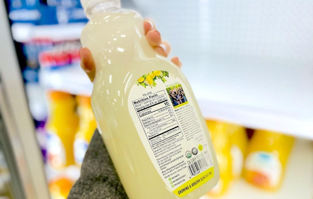 hand holding bottle of sugar free lemonade showing nutrition label