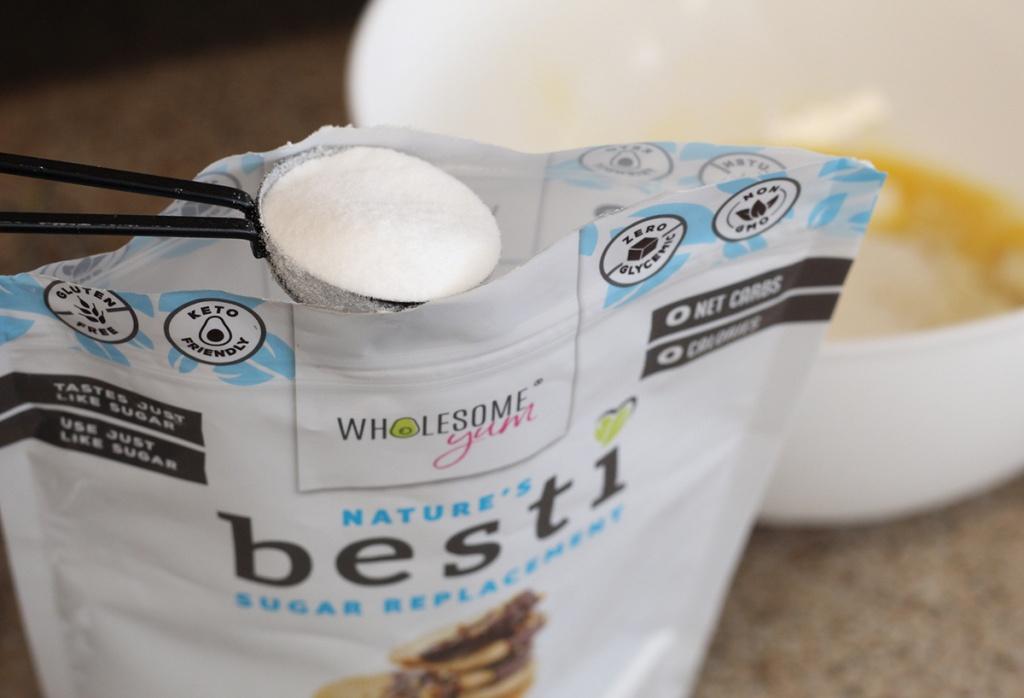 wholesome yum besti keto sweetener with measuring spoon