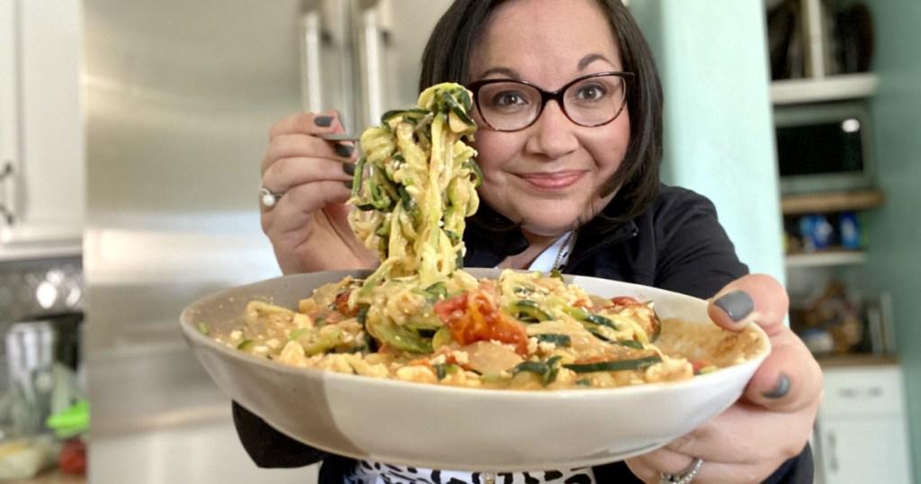 woman eating keto baked feta tomato pasta
