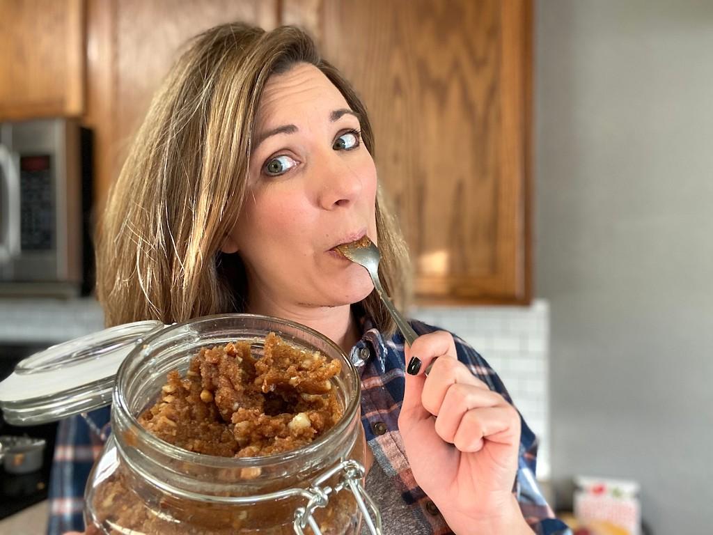 woman enjoying a spoonful of edible keto cookie dough