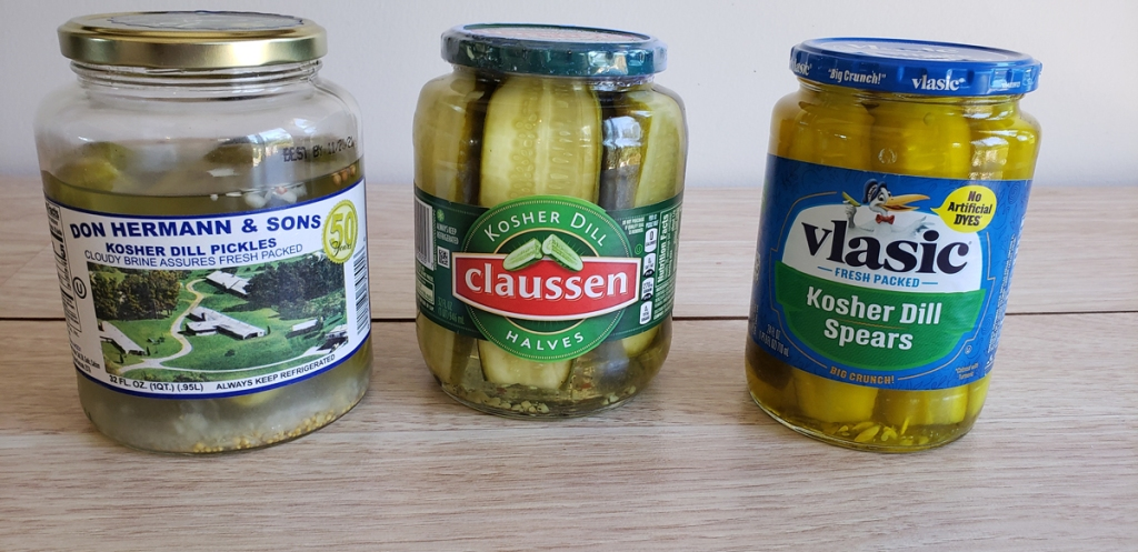 3 jars of pickles on counter