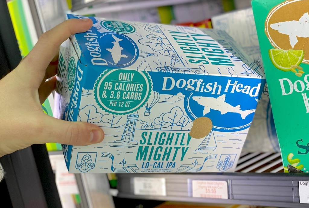 hand pulling case of dogfish head beer out of fridge