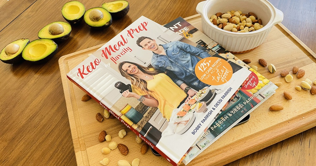 FlavCity keto meal prep cookbook on cutting board