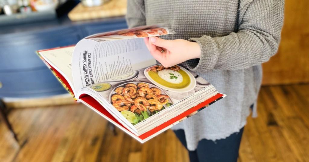 flipping through keto cookbook