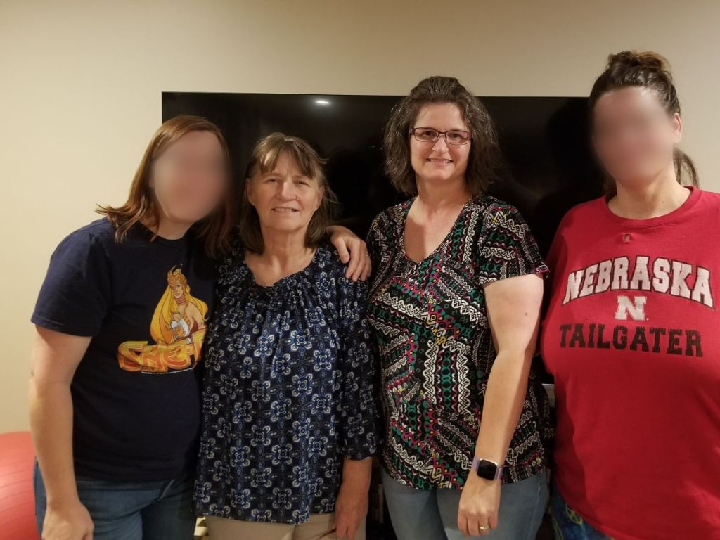 4 women in a family photo