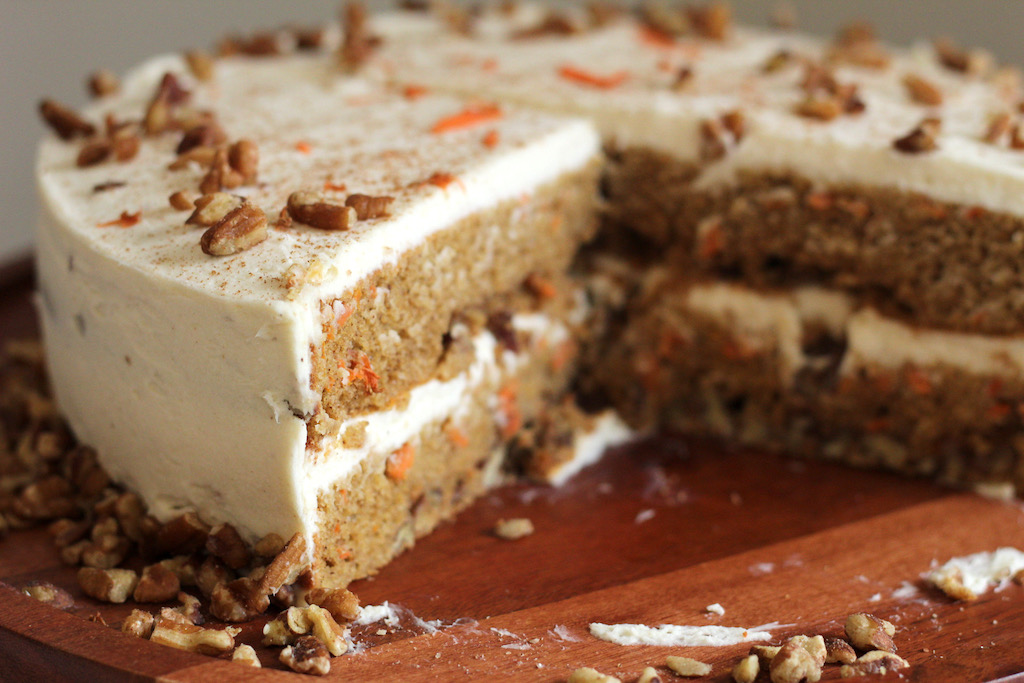 keto carrot cake with big slice out of it