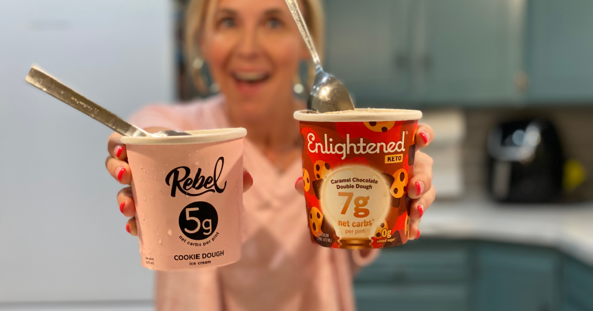 woman holding two different pints of keto ice cream