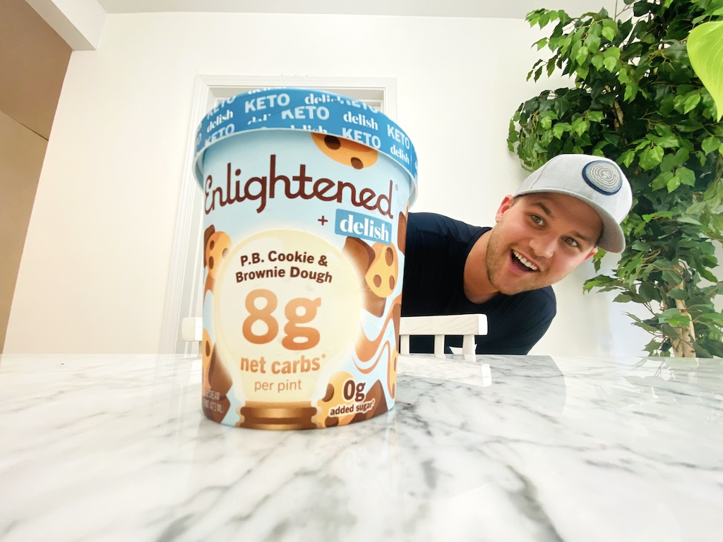 man looking at Enlightened keto collection ice cream