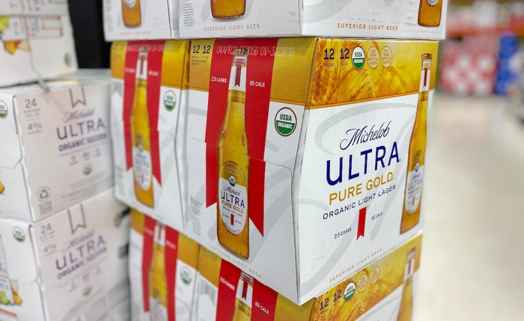 cases of michelob ultra pure gold beer stacked in pile
