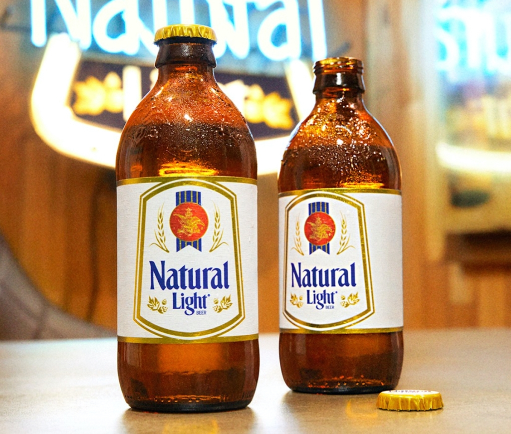 two glass bottles of natural light beer on bar top