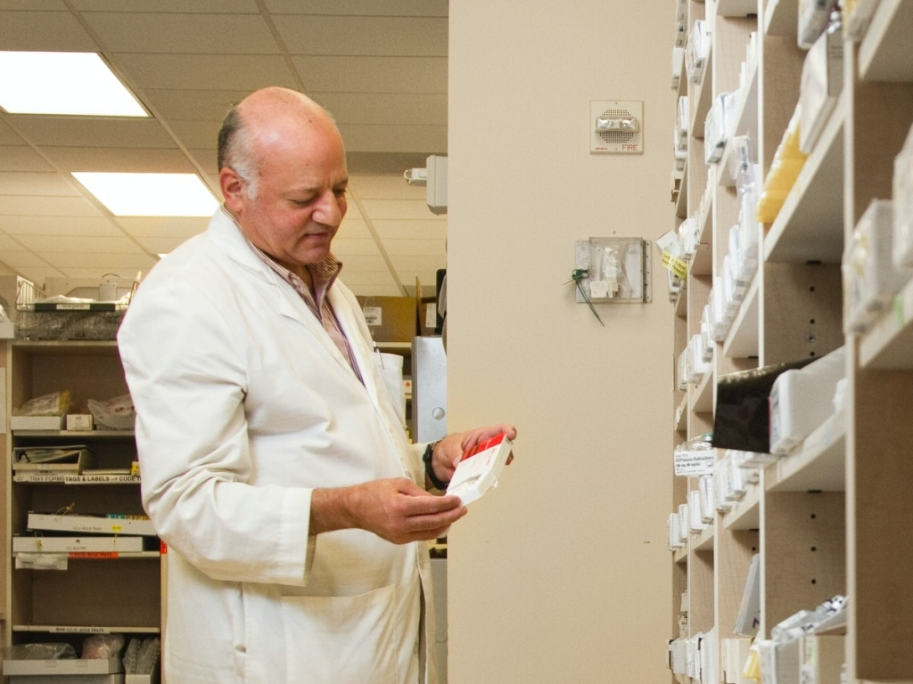 pharmacist holding medication to lower cortisol levels