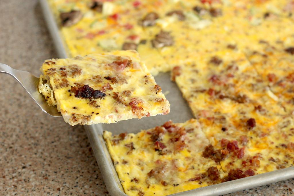 serving slice of sheet pan omlette
