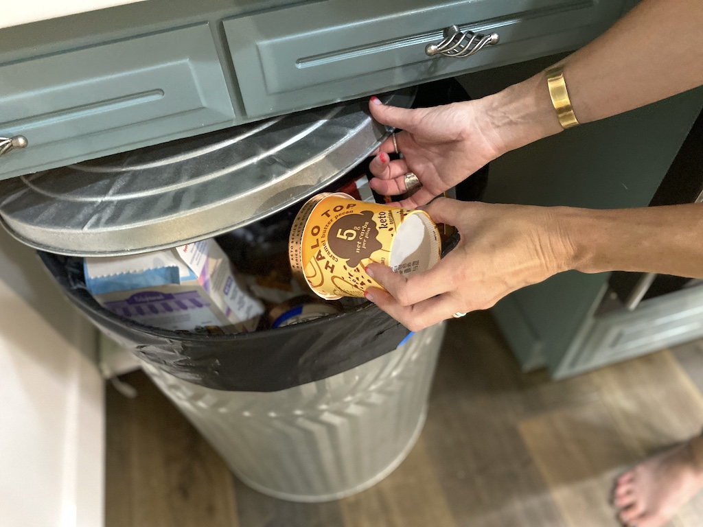 Throwing Halo Top ice cream in the trash can
