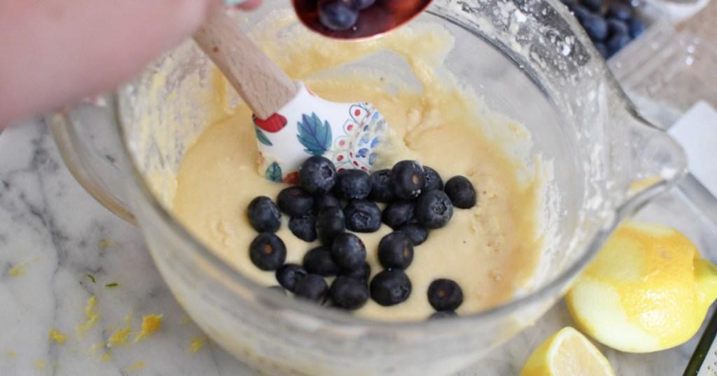 adding blueberries to pound cake