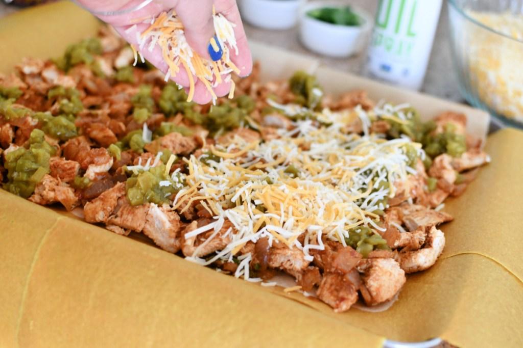 adding cheese to keto sheet pan quesadilla