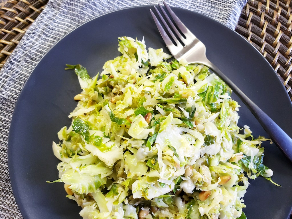 brussels sprout salad on plate with fork