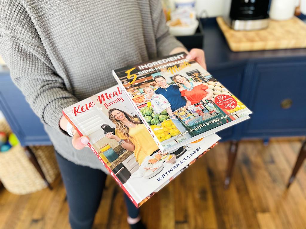 holding FlavCity keto cookbooks