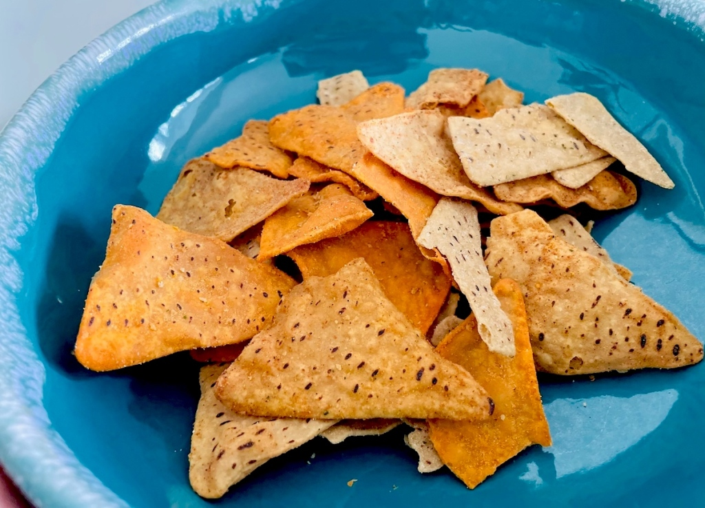 close up of blue bowl full of chips