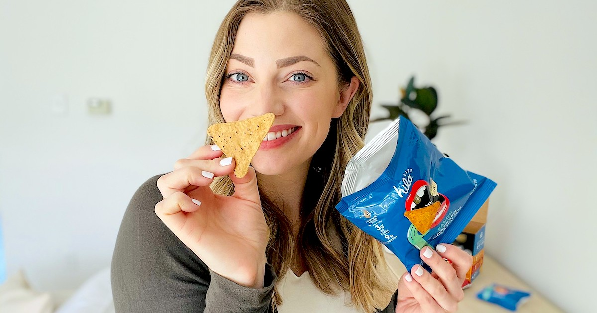 woman holding bag of hilo chips showing close up of chip