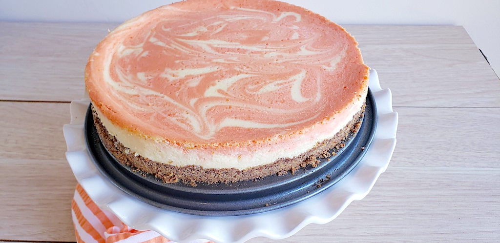 keto orange creamsicle cheesecake on pan