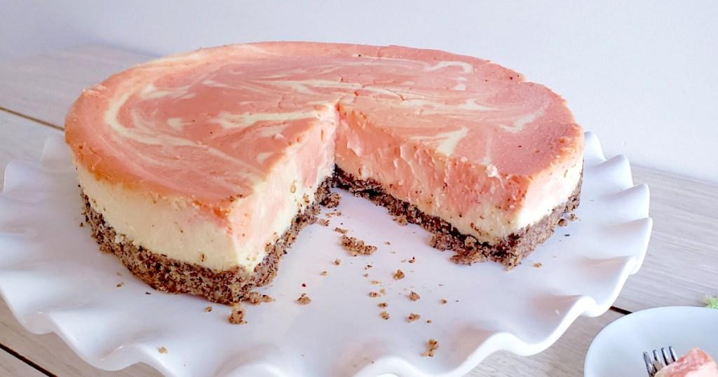 keto orange creamsicle cheesecake with slice missing