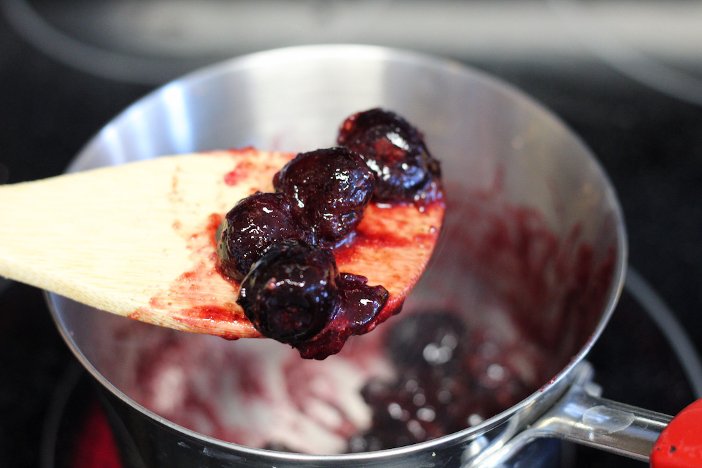wooden spoon with mashed up cherries