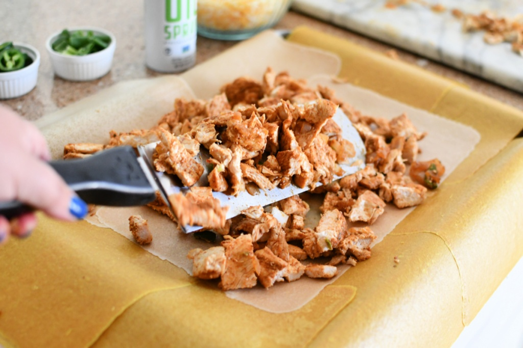 putting chicken in keto sheet pan quesadilla