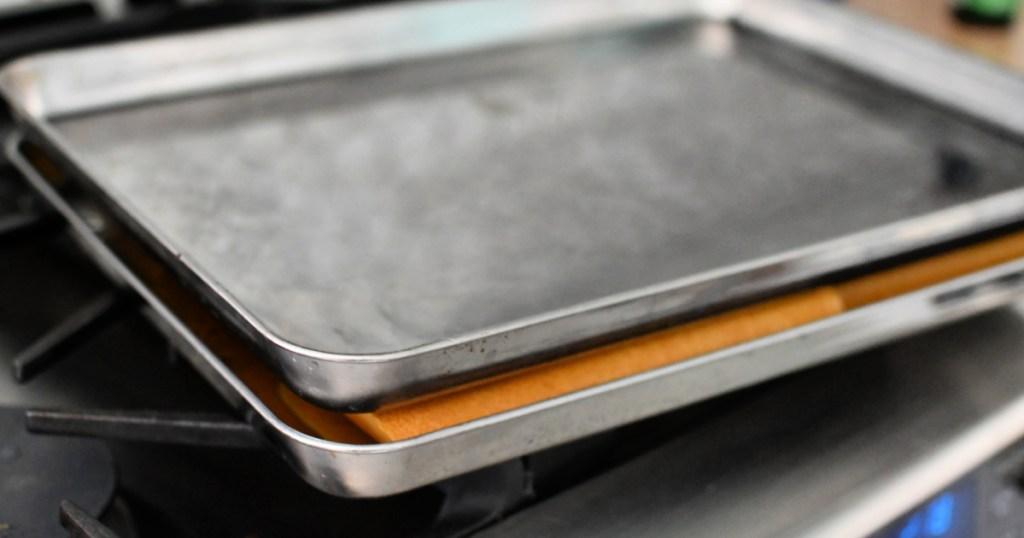 stacking sheet pan on top of quesadilla