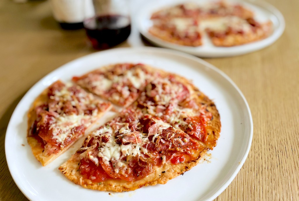 two keto meat lovers pizzas with keto wine in background