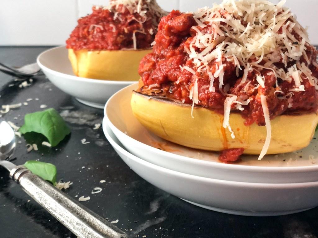 keto marinara sauce on spaghetti squash topped with parmesan