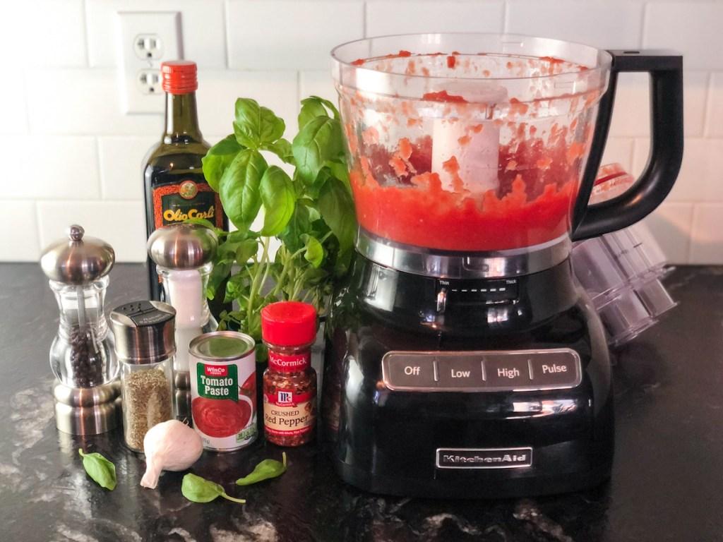 blended tomatoes next to marinara ingredients