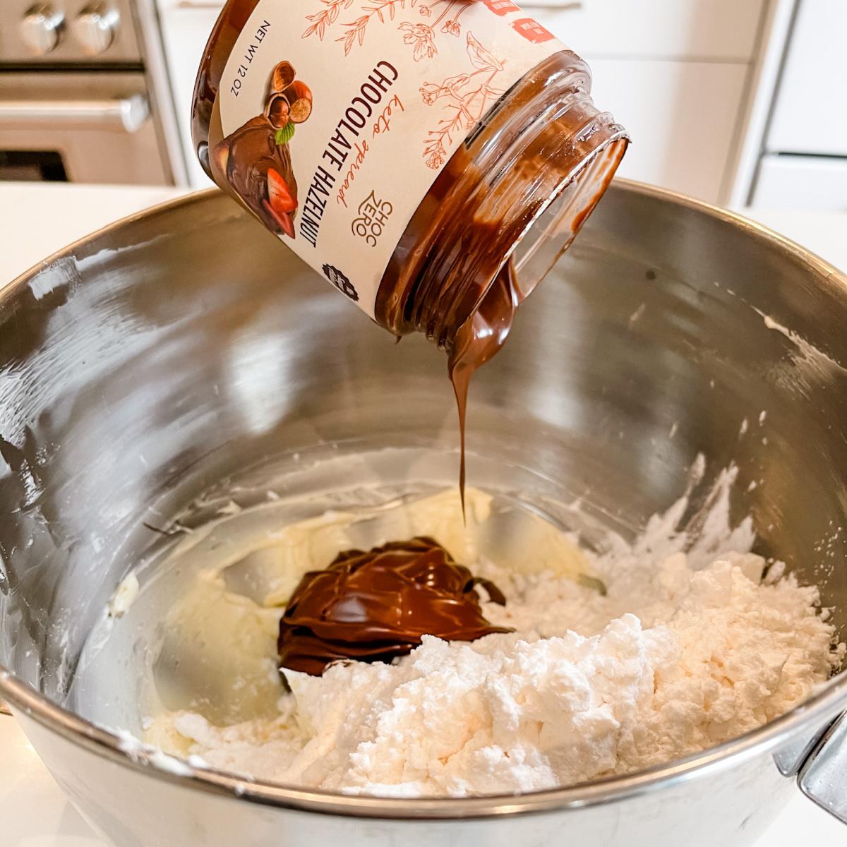 ChocZero chocolate hazelnut spread dripping into bowl