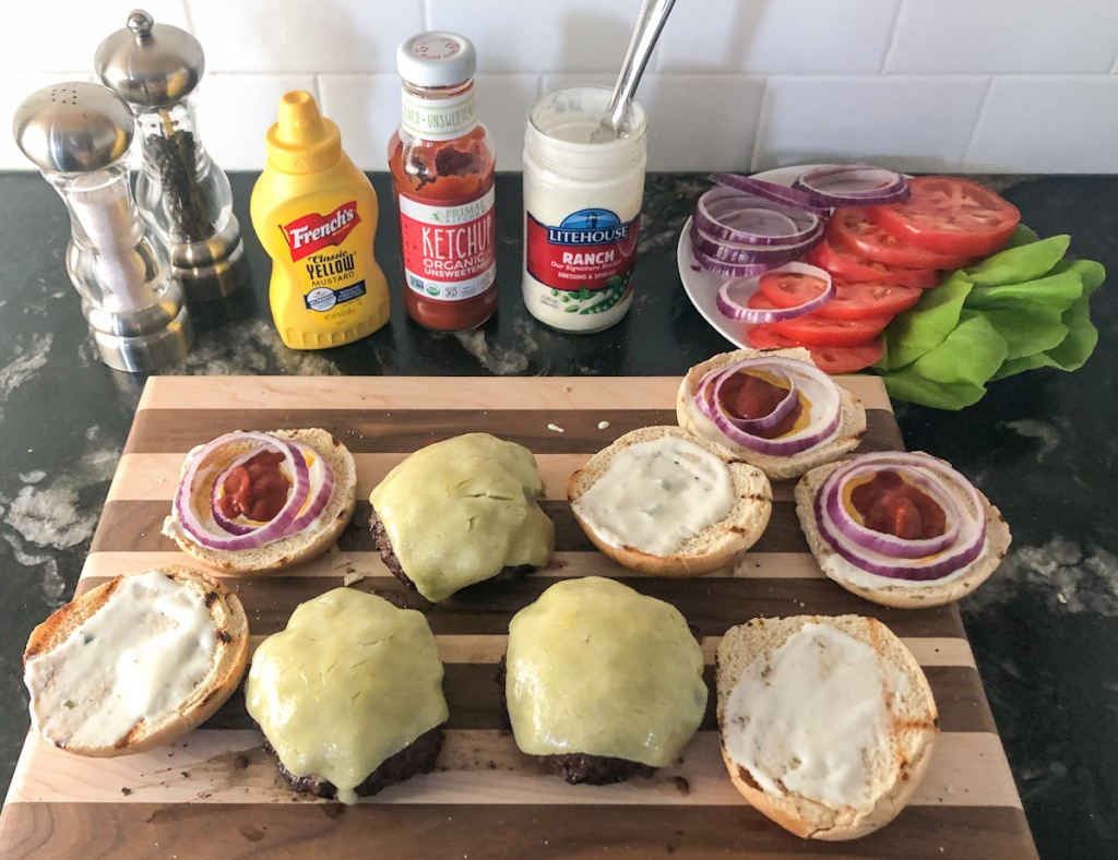 cooked burgers with toppings