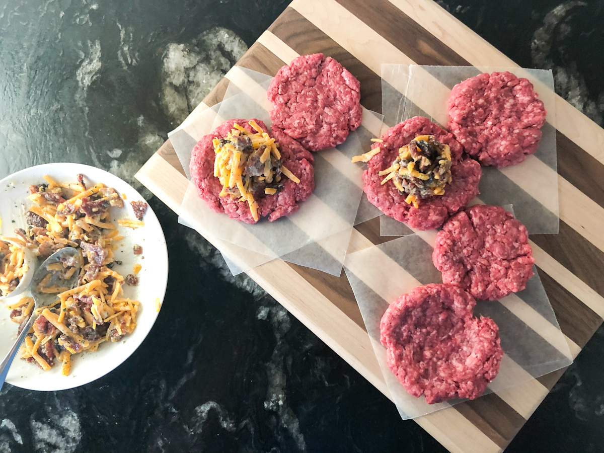 raw hamburger patties with filling