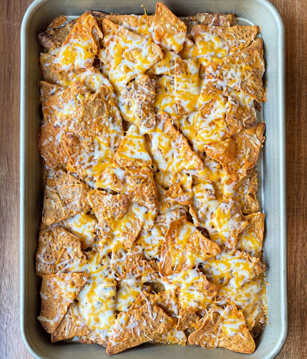 melted shredded cheese on HILO LIFE tortilla style chips