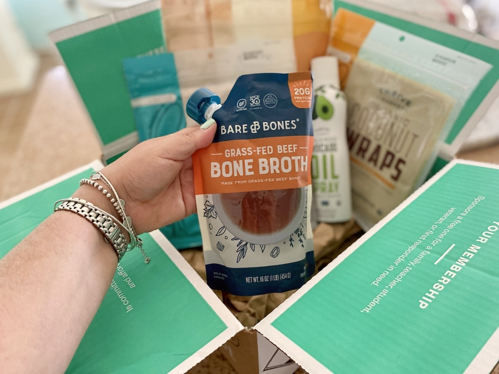 holding pouch of beef bone broth