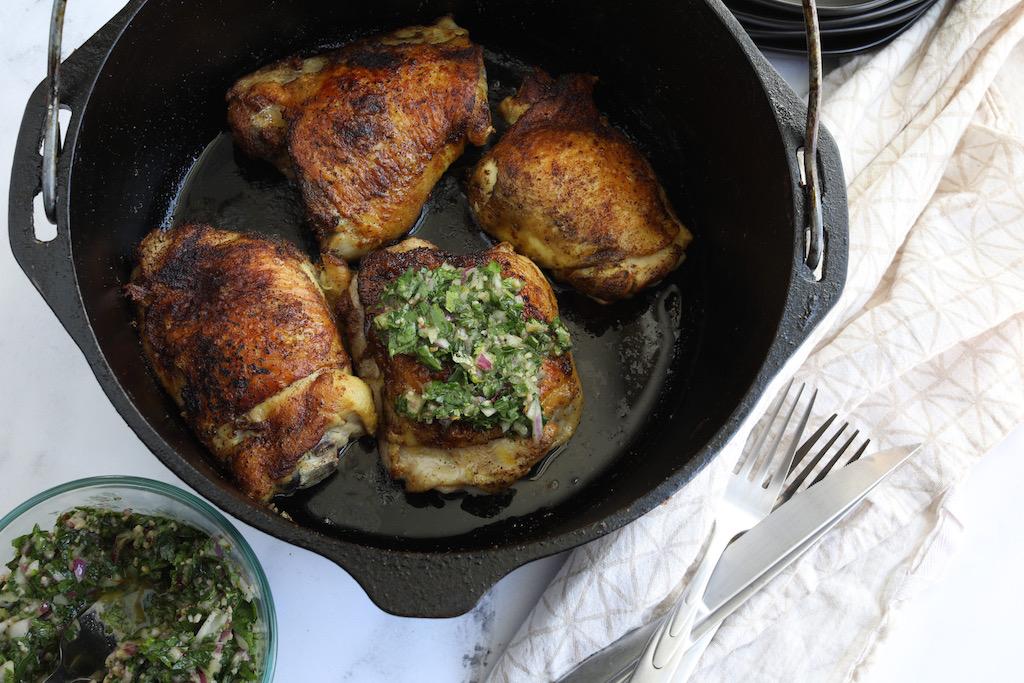 chicken thighs in cast iron pan