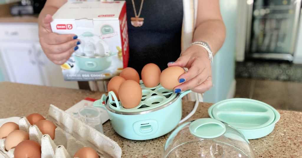 placing eggs in a dash express egg cooker