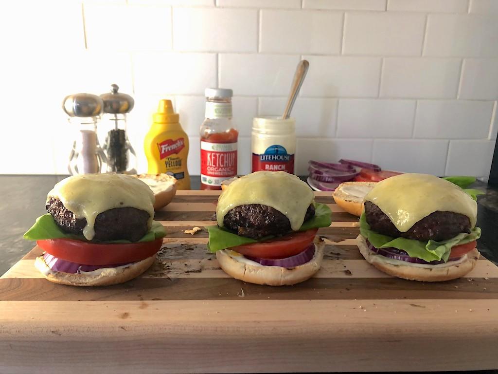 stuffed burgers on keto bun with sliced cheese