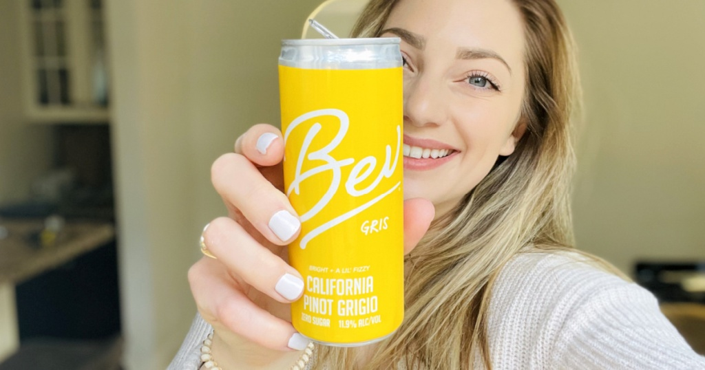 woman holding Bev canned wine