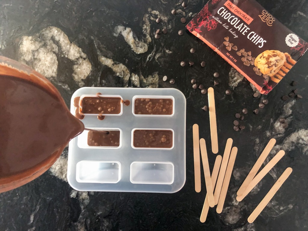 pouring chocolate mixture into molds