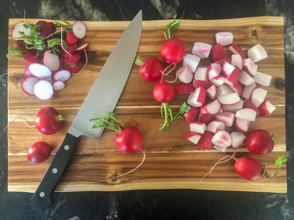 radishes on a cutting board